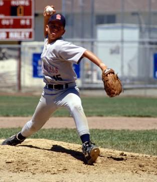 youth baseball player pitching