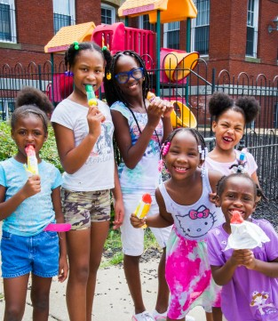group of girls eating popsicles at Perry school community day Northwest One
