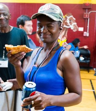 Woman enjoying food at Perry school community day Northwest One